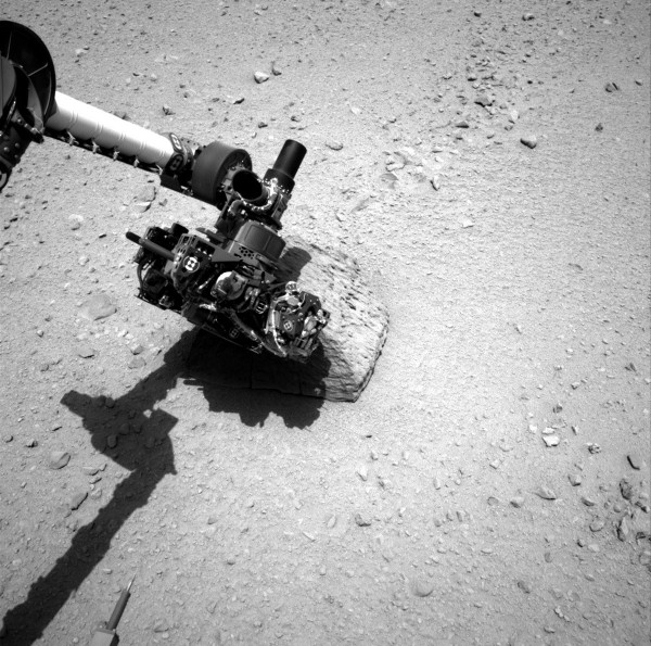This NASA handout image shows the robotic arm of the Mars rover Curiosity with the first rock touched by the Alpha Particle X-Ray Spectrometer